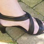 black sandals and red nailpolish